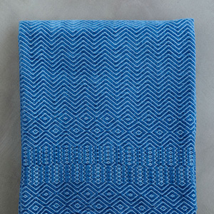 photo of hand-woven blue throw